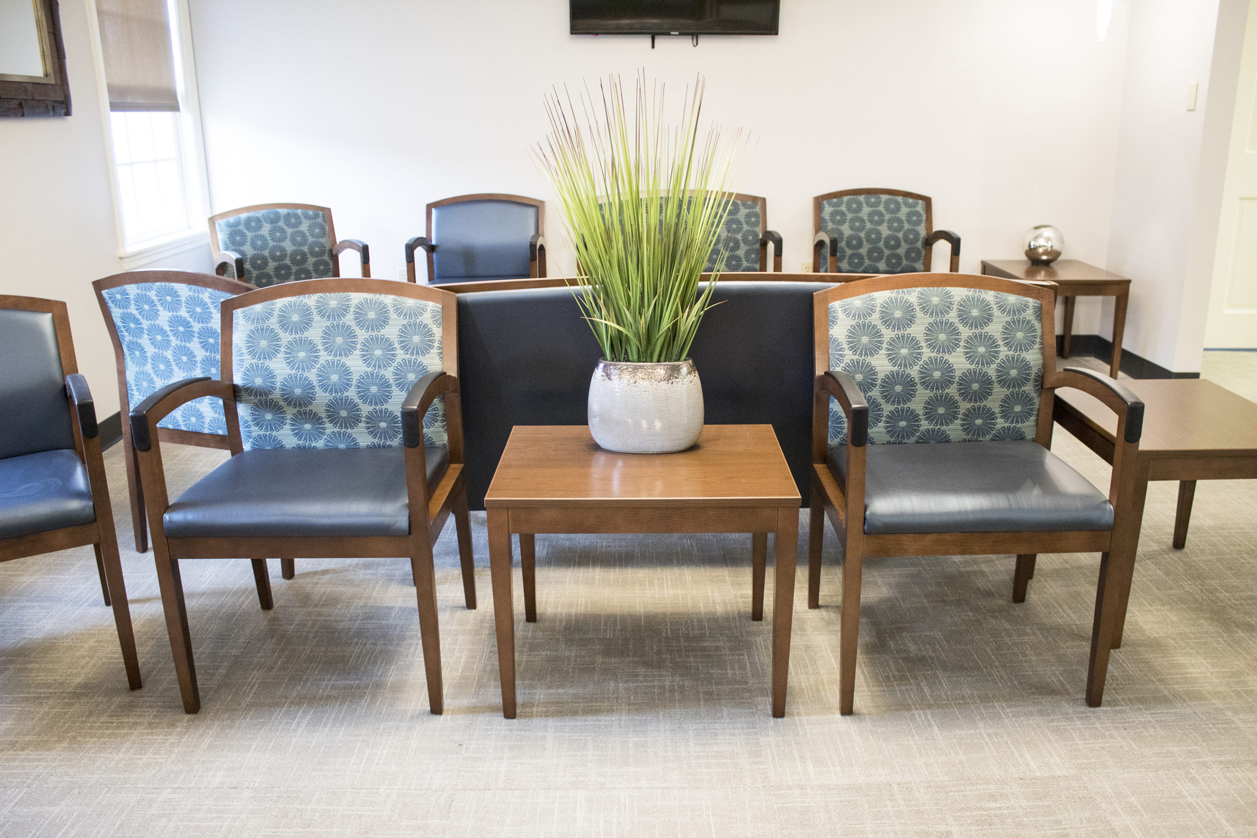 Two Chairs and Table in Waiting Room